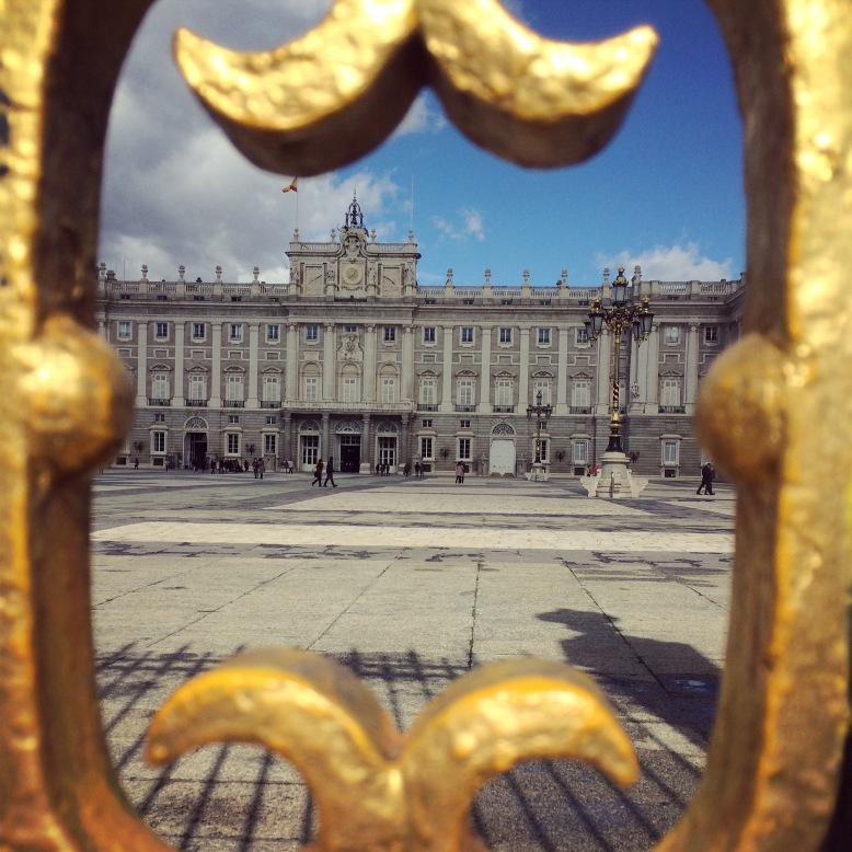 Royal Palace in Madrid framed by the gated entrance